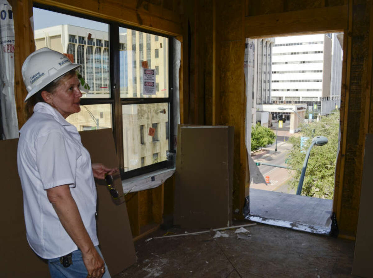 Project superintendent Angel Warner shows one of the views from a fourth floor loft as construction on the Wall Street Lofts continues as builders ready the new apartments and lofts for residents. Tim Fischer\Reporter-Telegram