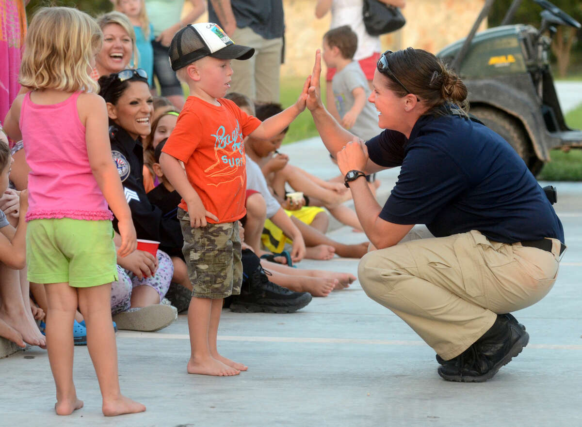 MPD canine officer Molly Pehl talks with four-year-old Deacon Adkins during National Night Out in 2014. James Durbin/Reporter-Telegram