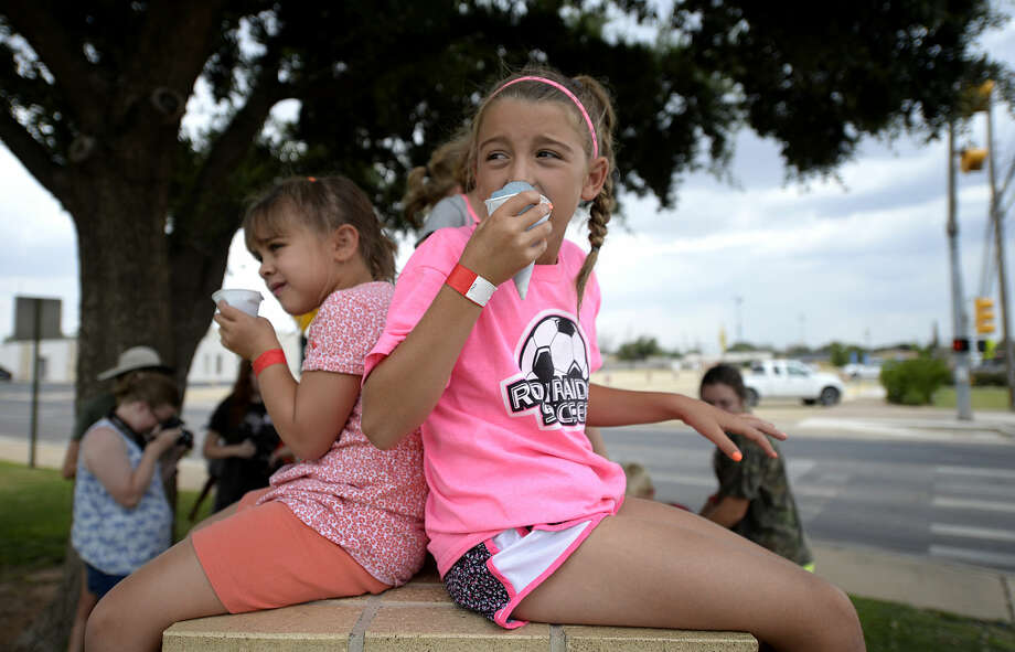 Children at the First Baptist Church day camp keep cool with snow cones as the temperature approaches 100 degrees  early this month. James Durbin/Reporter-Telegram Photo: James Durbin