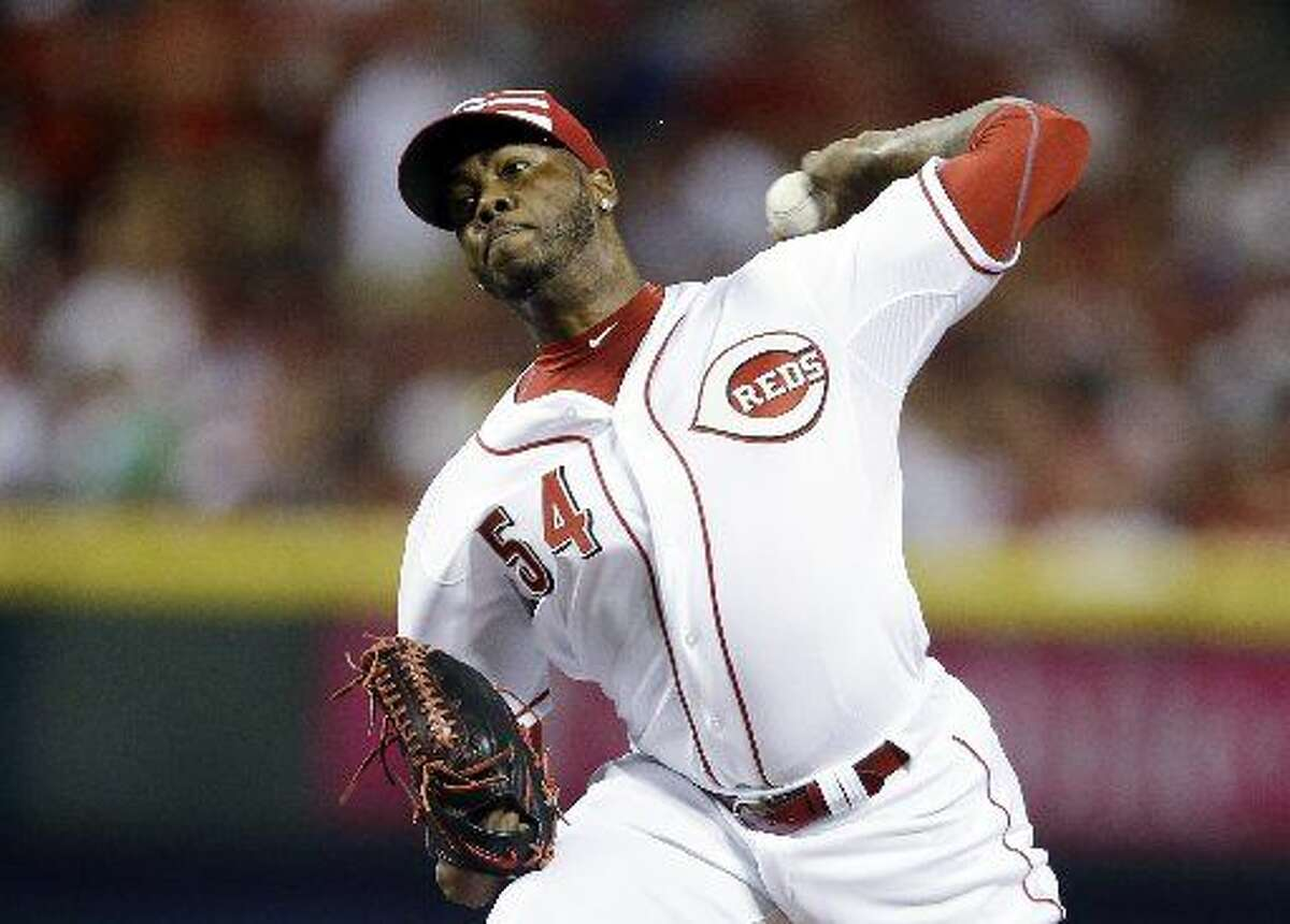National League's Aroldis Chapman, of the Cincinnati Reds, throws during the ninth inning of the MLB All-Star baseball game, Tuesday, July 14, 2015, in Cincinnati.