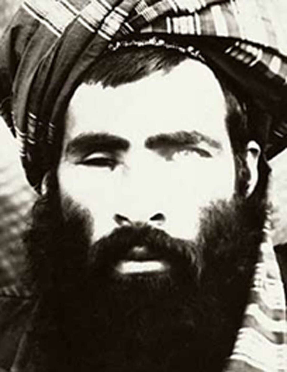 FILE - The Afghan government said on Wednesday, July 29, 2015, that it was investigating new reports that Mullah Muhammad Omar, the elusive leader of the Taliban, is dead. A photo believed to be of Mullah Omar which is part of a wanted poster produced by the FBI. (FBI via The New York Times)
