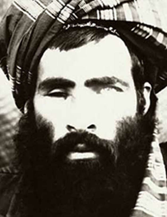 FILE - The Afghan government said on Wednesday, July 29, 2015, that it was investigating new reports that Mullah Muhammad Omar, the elusive leader of the Taliban, is dead. A photo believed to be of Mullah Omar which is part of a wanted poster produced by the FBI. (FBI via The New York Times) Photo: FBI