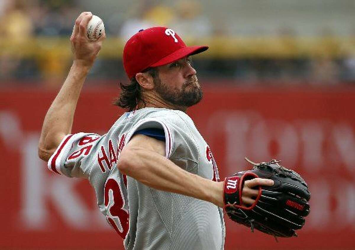In this June 14, 2015, file photo, Philadelphia Phillies starting pitcher Cole Hamels delivers in the first inning of a baseball game against the Pittsburgh Pirates in Pittsburgh. Two people familiar with the deal say the Phillies have agreed to trade Hamels to the Texas Rangers for a package of prospects. Both people spoke to The Associated Press late Wednesday night, July 29, 2015, on condition of anonymity because the trade has not been finalized. Hamels has a limited no-trade clause but does not have to approve a deal to the Rangers.