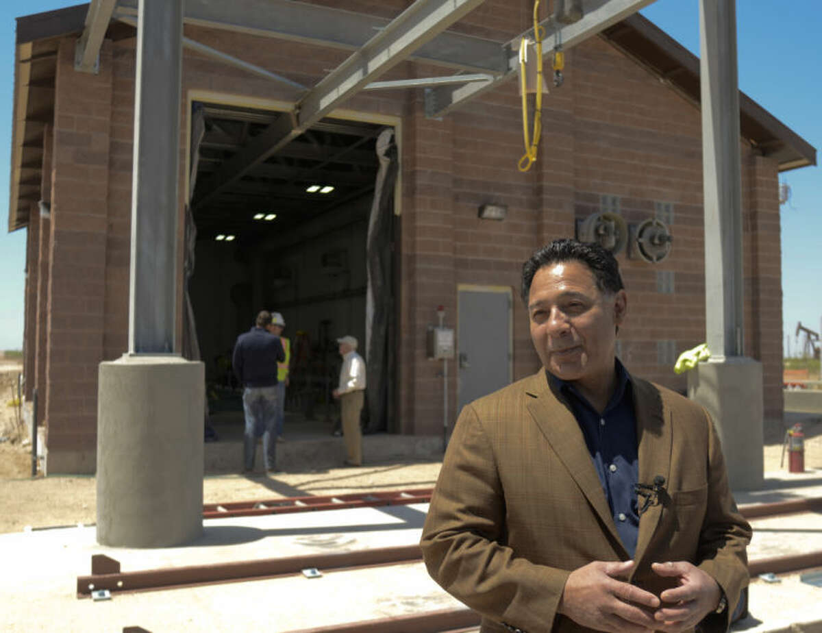 (File Photo) Jose Cuevas talks to the media Friday in front of the city's chlorination building to treat the water coming in from the T-Bar Ranch. Tim Fischer\Reporter-Telegram 4-19-13