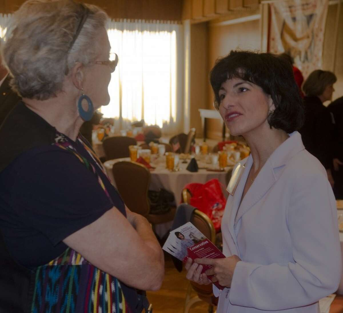 (FILE PHOTO) Christi Craddick speaks with Jan Brown Wednesday before the Midland County Republican Women's luncheon. Photo by Tim Fischer\ Reporter-Telegram