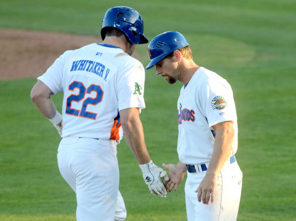 RockHounds' Josh Whitaker is congratulated by manager Aaron Nieckula after hitting a home run against Corpus Christi on Tuesday at Security Bank Ballpark. James Durbin/Reporter-Telegram