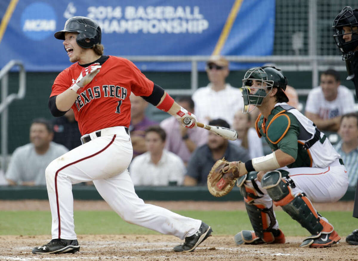 Texas Tech's Tim Proudfoot (1) follows through on a single as Miami catcher Garrett Kennedy looks on in the seventh inning during an NCAA college baseball regional tournament in Coral Gables, Fla., Monday, June 2, 2014. Texas Tech defeated Miami 4-0 to advance to the Super Regionals. (AP Photo/Lynne Sladky)