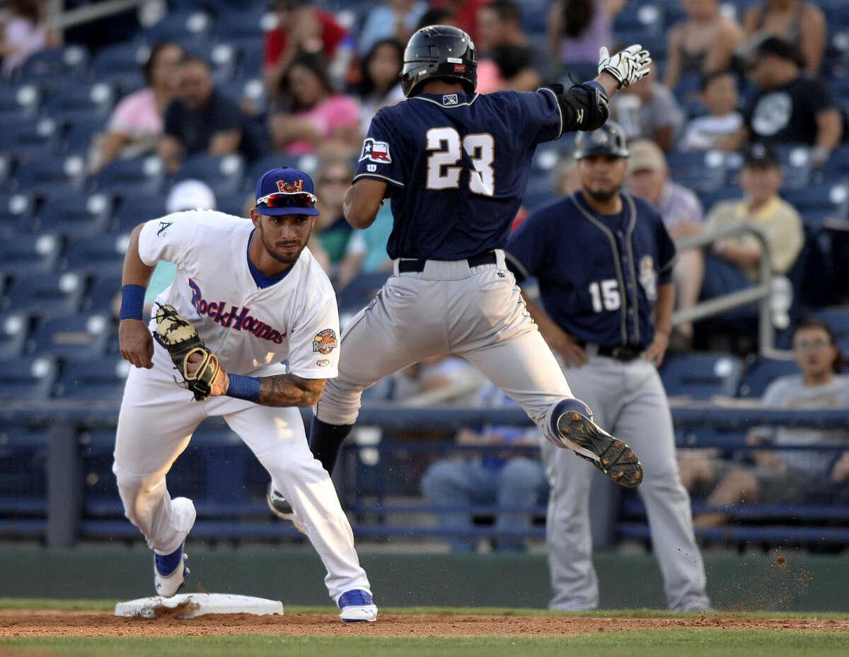 Rockhounds first baseman Rangel Ravelo gets an out against San Antonio's Tyson Gillies on Thursday, July 23, 2015 at Security Bank Ballpark. James Durbin/Reporter-Telegram