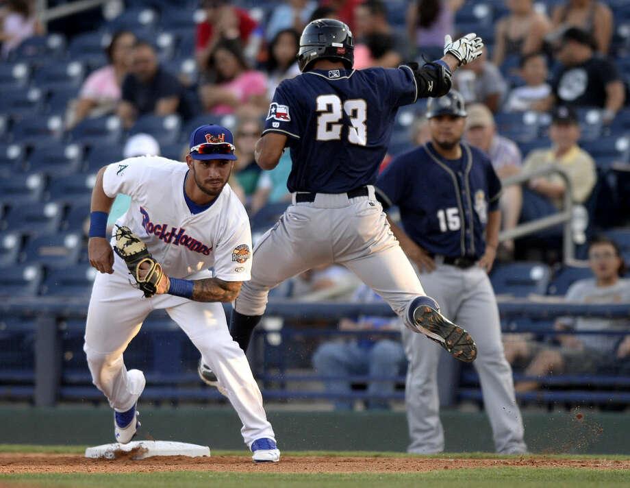 Rockhounds first baseman Rangel Ravelo gets an out against San Antonio's Tyson Gillies on Thursday, July 23, 2015 at Security Bank Ballpark. James Durbin/Reporter-Telegram Photo: James Durbin