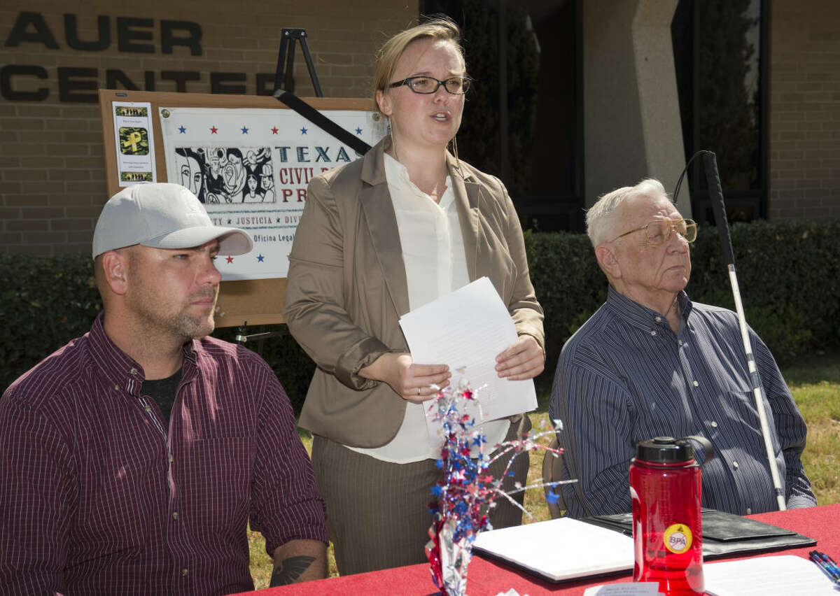 Cassandra Champion, center, regional director and Veterans rights attorney with Texas Civil Rights Projects, speaks Monday 7-27-15, with U.S. Army veteran Richard Vernon and Melvin Burdick, right, who is visually impaired. Tim Fischer\Reporter-Telegram