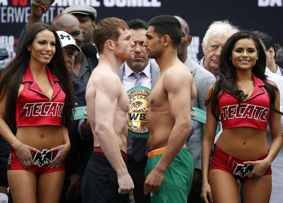 Canelo Alvarez, center left, and Amir Khan, center right, pose during a weigh-in Friday, May 6, 2016, in Las Vegas. The two are scheduled to fight in a middleweight championship bout Saturday in Las Vegas. (AP Photo/John Locher) Photo: John Locher, Associated Press