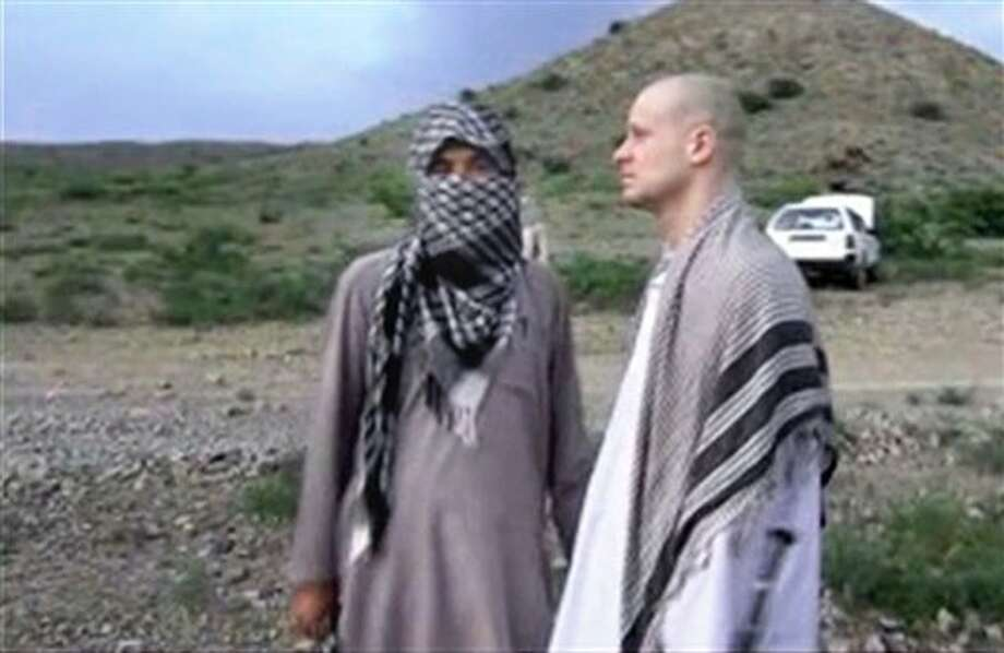 In this image taken from video obtained from Voice Of Jihad Website, which has been authenticated based on its contents and other AP reporting, Sgt. Bowe Bergdahl, right, stands with a Taliban fighter in eastern Afghanistan. The Taliban on Wednesday, June 4, 2014, released a video showing the handover of Bergdahl to U.S. forces in eastern Afghanistan, touting the swap of the American soldier for five Taliban detainees from Guantanamo as a significant achievement for the insurgents. Bergdahl was freed on Saturday after five years in captivity, and exchanged for the five Guantanamo detainees who were flown to Qatar, a tiny Gulf Arab country which has served as a mediator in the negotiations for the swap. (AP Photo/Voice Of Jihad Website via AP video) Photo: Uncredited / AP2014