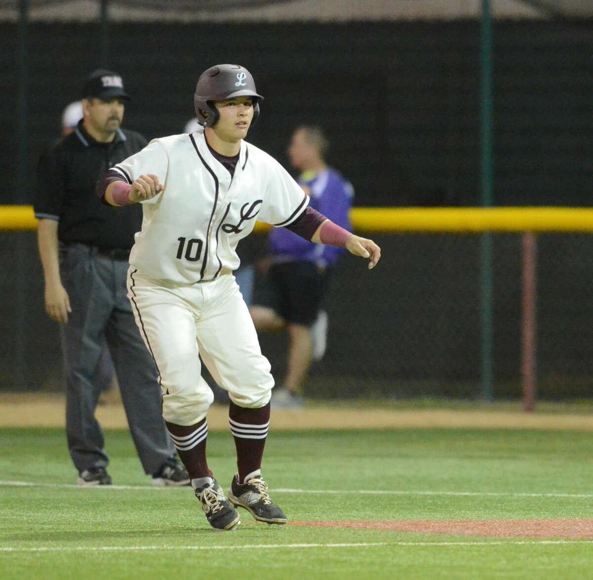 Lee High's Hunter Coleman leads off from first base against Midland High on Friday, April 10, 2015 at Christensen Stadium. James Durbin/Reporter-Telegram
