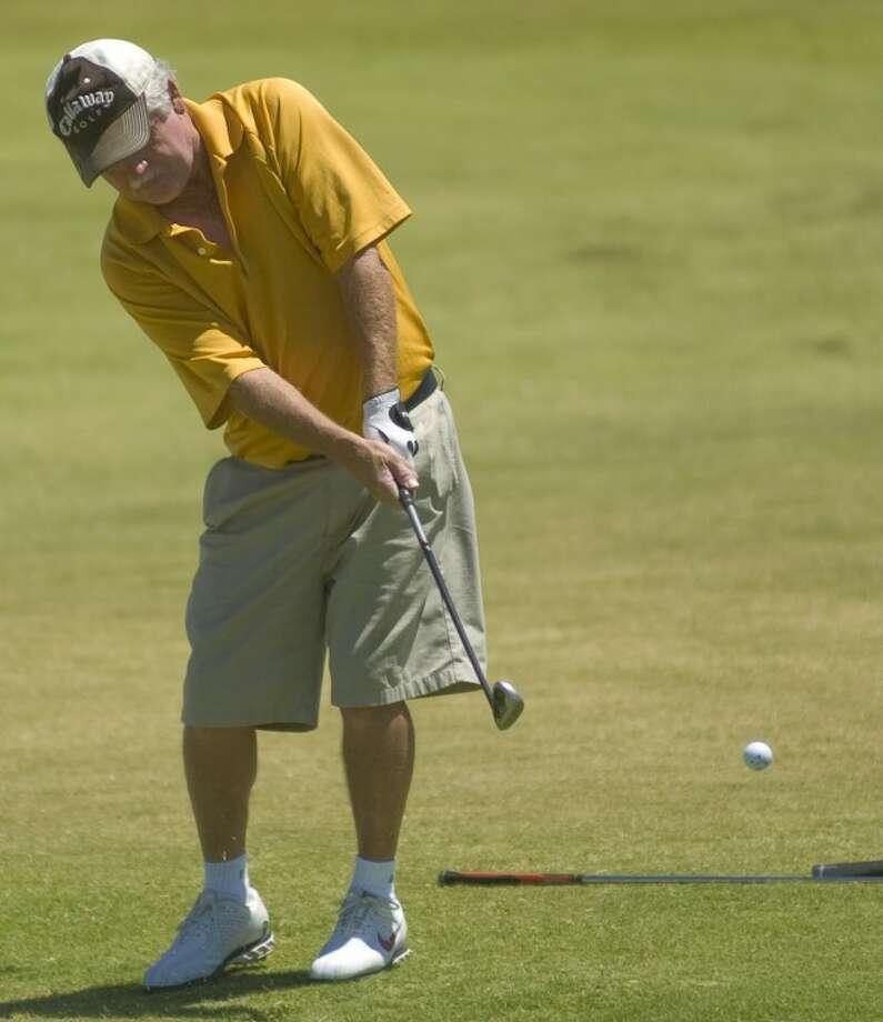 Ronnie Jumper chips onto the green Sunday in the Men's City Golf Championship at Hogan Park. Photo by Tim Fischer/Midland Reporter-Telegram Photo: Tim Fischer