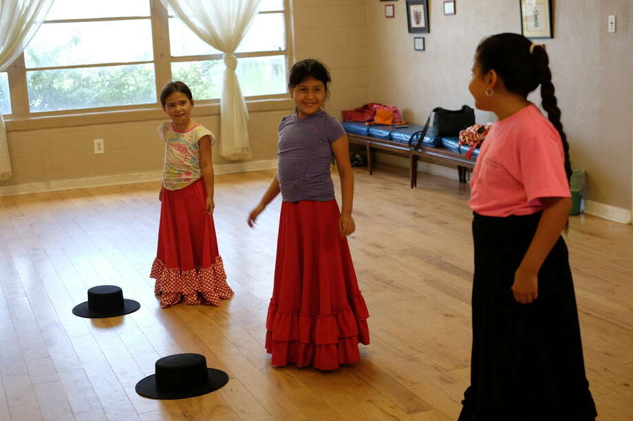 Catalina Gomez ,5, from left, Kamila Camacho, 7, and Kayla Ramos, 10, are taking a flamenco class at the Hispanic Cultural Center of Midland.