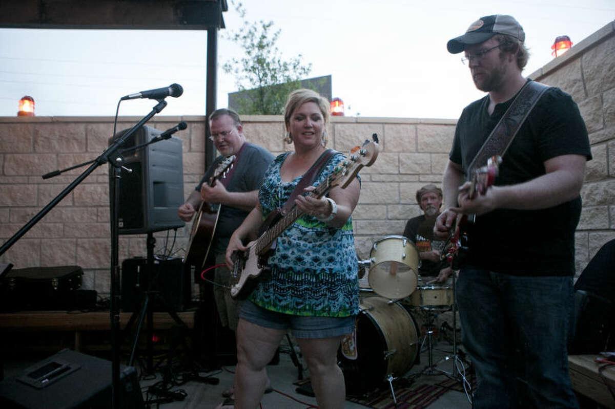 The Unsweet Teas play a show on the patio at Basin Burger House on Thursday. James Durbin/Reporter-Telegram