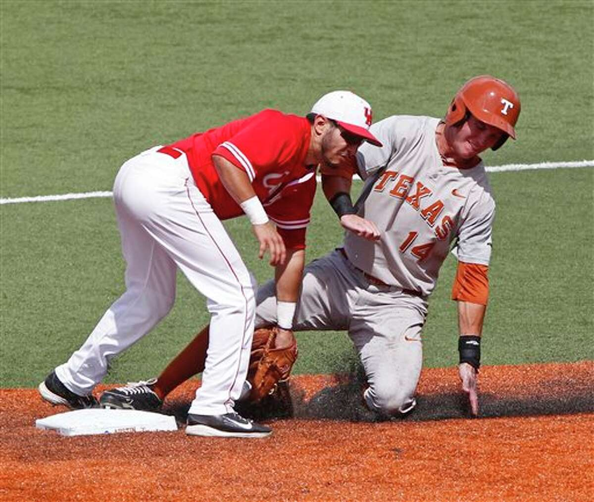 Texas' Ben Johnson (14) steals second against Houston's Josh Vidales (8) in the fifth inning of an NCAA college baseball tournament super regional game in Austin, Texas, Friday, June 6, 2014. (AP Photo/Michael Thomas)