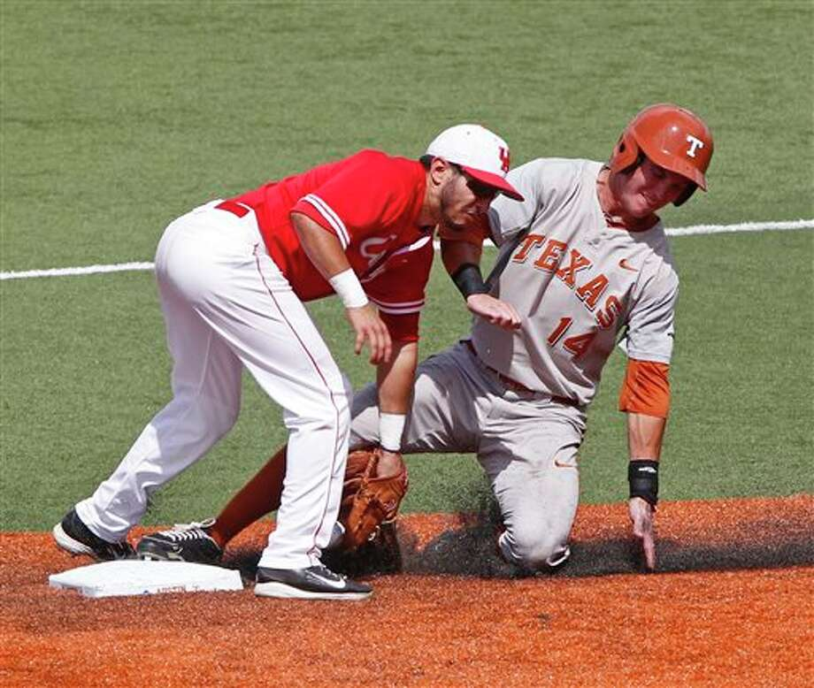 Texas' Ben Johnson (14) steals second against Houston's Josh Vidales (8) in the fifth inning of an NCAA college baseball tournament super regional game in Austin, Texas, Friday, June 6, 2014. (AP Photo/Michael Thomas) Photo: Michael Thomas / FR65778 AP