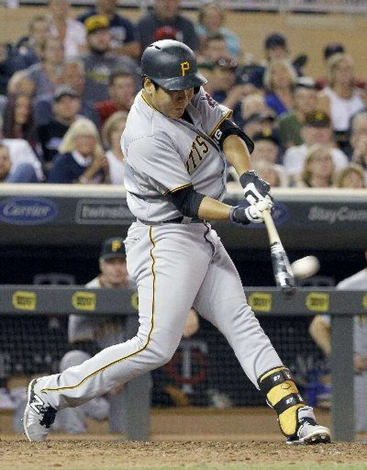 Pittsburgh Pirates' Jung Ho Kang hits a solo home run off Minnesota Twins relief pitcher Glen Perkins during the ninth inning of a baseball game in Minneapolis, Tuesday, July 28, 2015. The Pirates won 8-7. (AP Photo/Ann Heisenfelt) Photo: Ann Heisenfelt