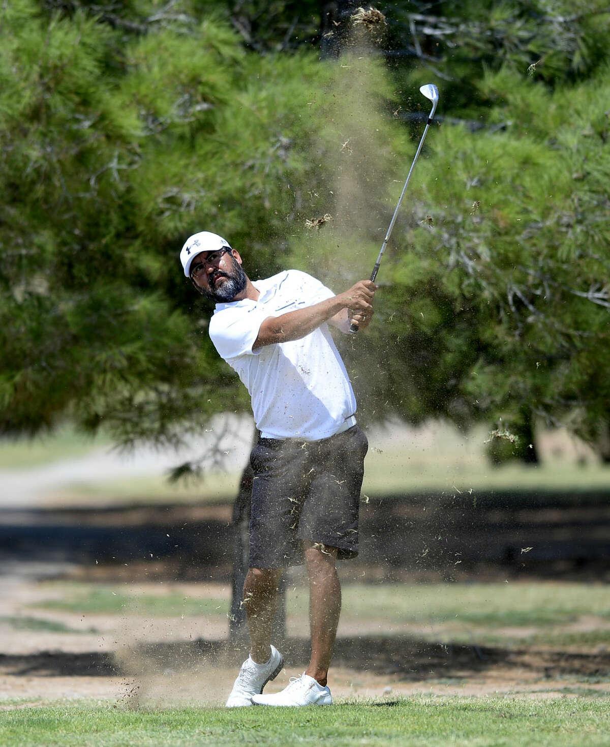 Ciro Baeza hits an approach shot during the Star Electric Men's City Championship on Saturday, August 1, 2015 at Hogan Park Golf Course. James Durbin/Reporter-Telegram