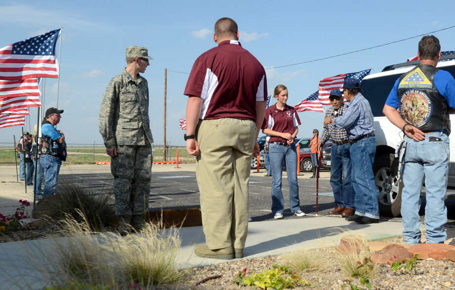 Veterans are escorted into the Permian Basin Honor Flight sendoff event on Wednesday, May 27, 2015, at the CAF. James Durbin/Reporter-Telegram Photo: James Durbin