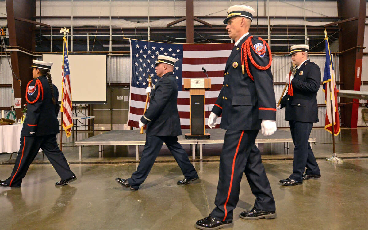 Midland Fire Department color guard members attend to the flags during the Permian Basin Honor Flight sendoff event on Wednesday, May 27, 2015, at the CAF. James Durbin/Reporter-Telegram