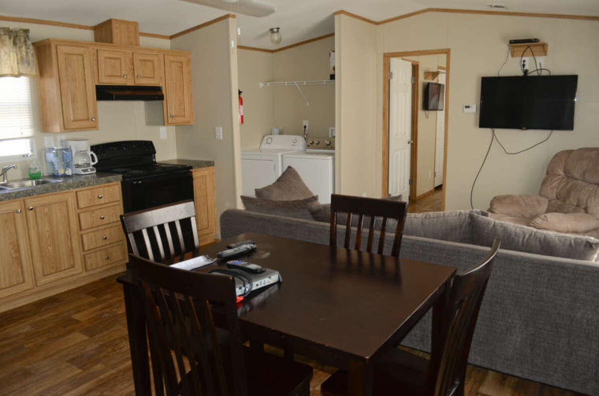 Crew Support Services offers affordable temporary housing with 3 and 4 bedroom trailers. A large central area has a full kitchen, washer and dryer and livingroom area with flat screen TV. Tim Fischer\Reporter-Telegram