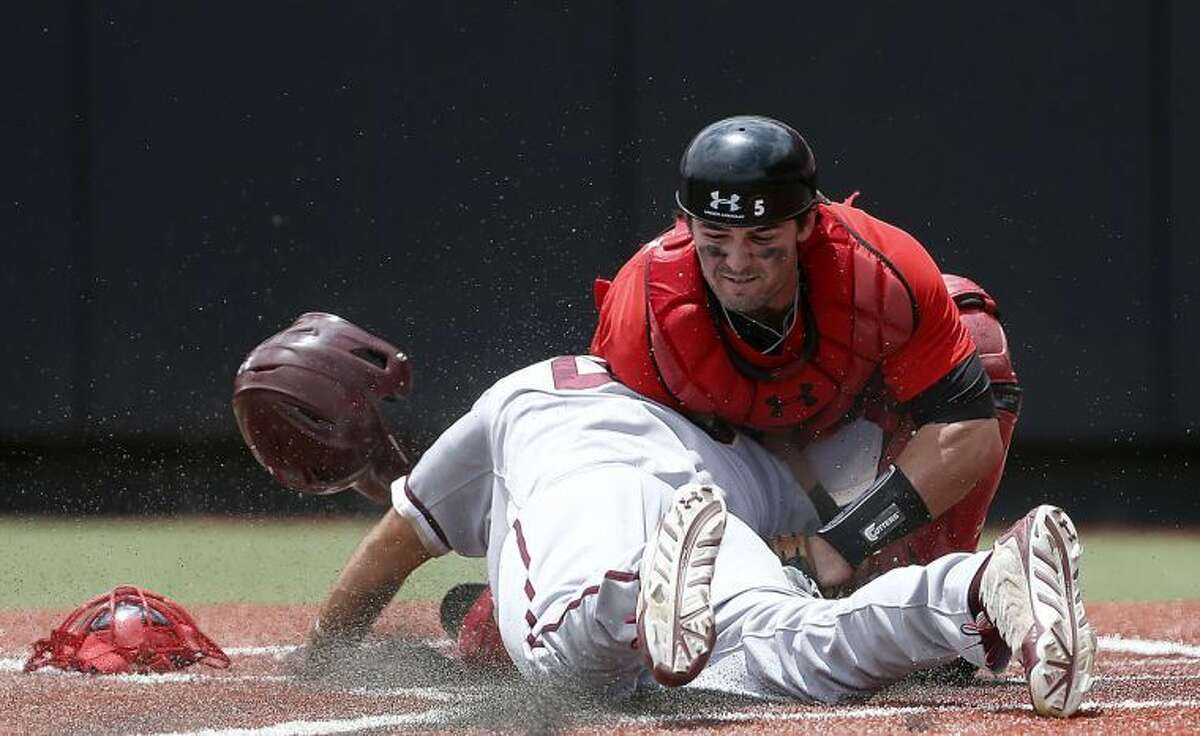 Texas Tech's Hunter Redman tags out College of Charleston's Brandon Glazer during an NCAA college baseball tournament super regional game in Lubbock, Texas, Saturday, June 7, 2014. Texas Tech won 1-0. (AP Photo/Lubbock Avalanche Journal, Shannon Wilson)