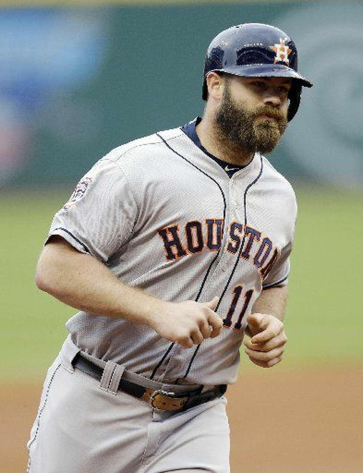 Houston Astros' Evan Gattis runs the bases after hitting a two-run home run off Cleveland Indians starting pitcher Trevor Bauer in the first inning of a baseball game, Wednesday, July 8, 2015, in Cleveland. Jose Altuve scored on the play. (AP Photo/Tony Dejak)