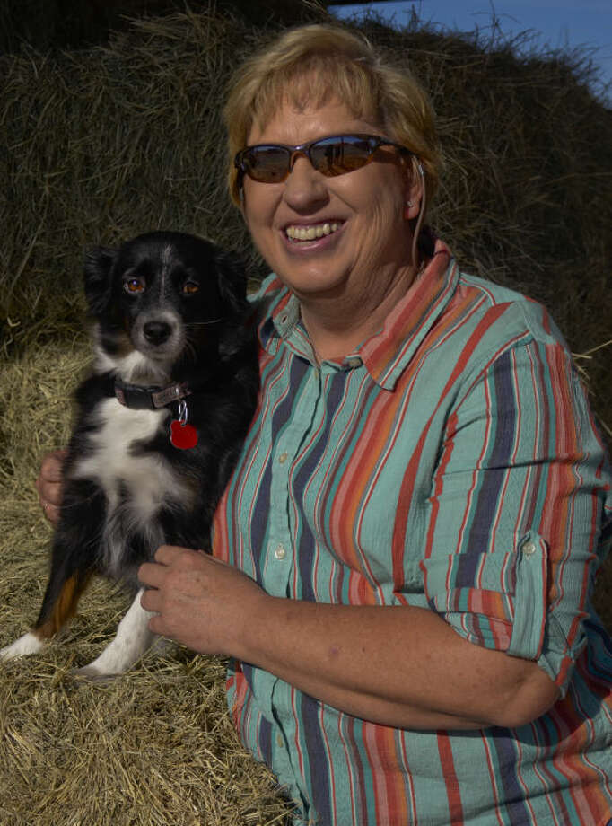 Kay Wessels and her dog Muffin, are the new general manager of the Midland Farmer's Co-Op. Tim Fischer\Reporter-Telegram Photo: Tim Fischer