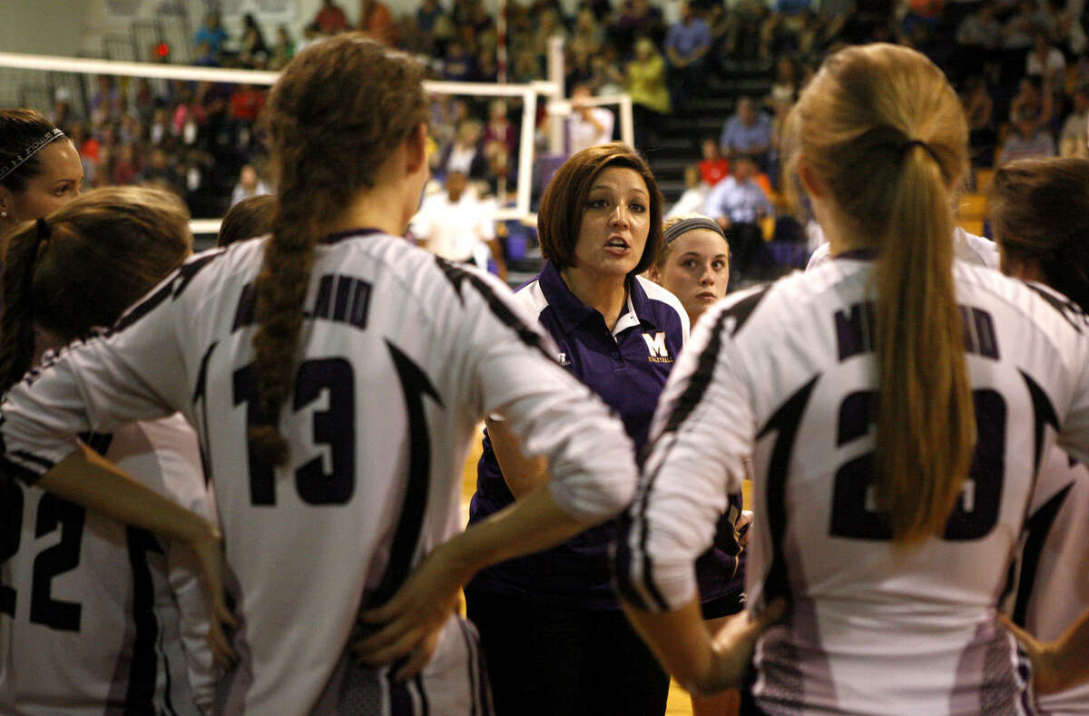 Midland High head volleyball coach Amanda Lopez talks to her team during a match against Lubbock Coronado last season in the Midland High gym. James Durbin/Reporter-Telegram