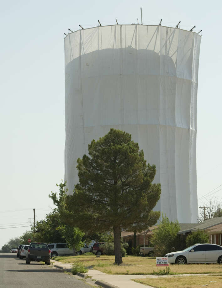Work continues Thursday 7-30-15, on the water tower on the corner of Edgewood and Storey Ave. Tim Fischer\Reporter-Telegram Photo: Tim Fischer