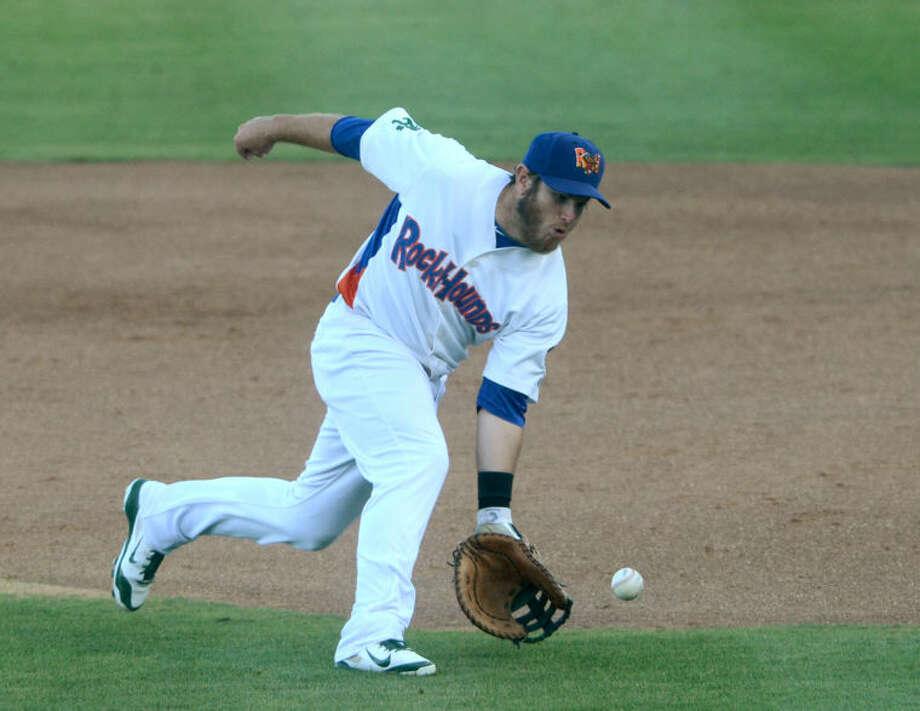 RockHounds first baseman Max Muncy fields the ball against Corpus Christi on June 3 at Security Bank Ballpark. James Durbin/Reporter-Telegram Photo: James Durbin