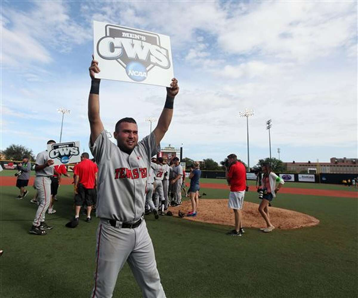Texas Tech's Eric Gutierrez holds up a College World Series sign after a win over College of Charleston in a NCAA college baseball super regional tournament game in Lubbock,Texas, Sunday, June 8, 2014. (AP Photo/Lubbock Avalanche Journal,Zach Long) LOCALTV OUT