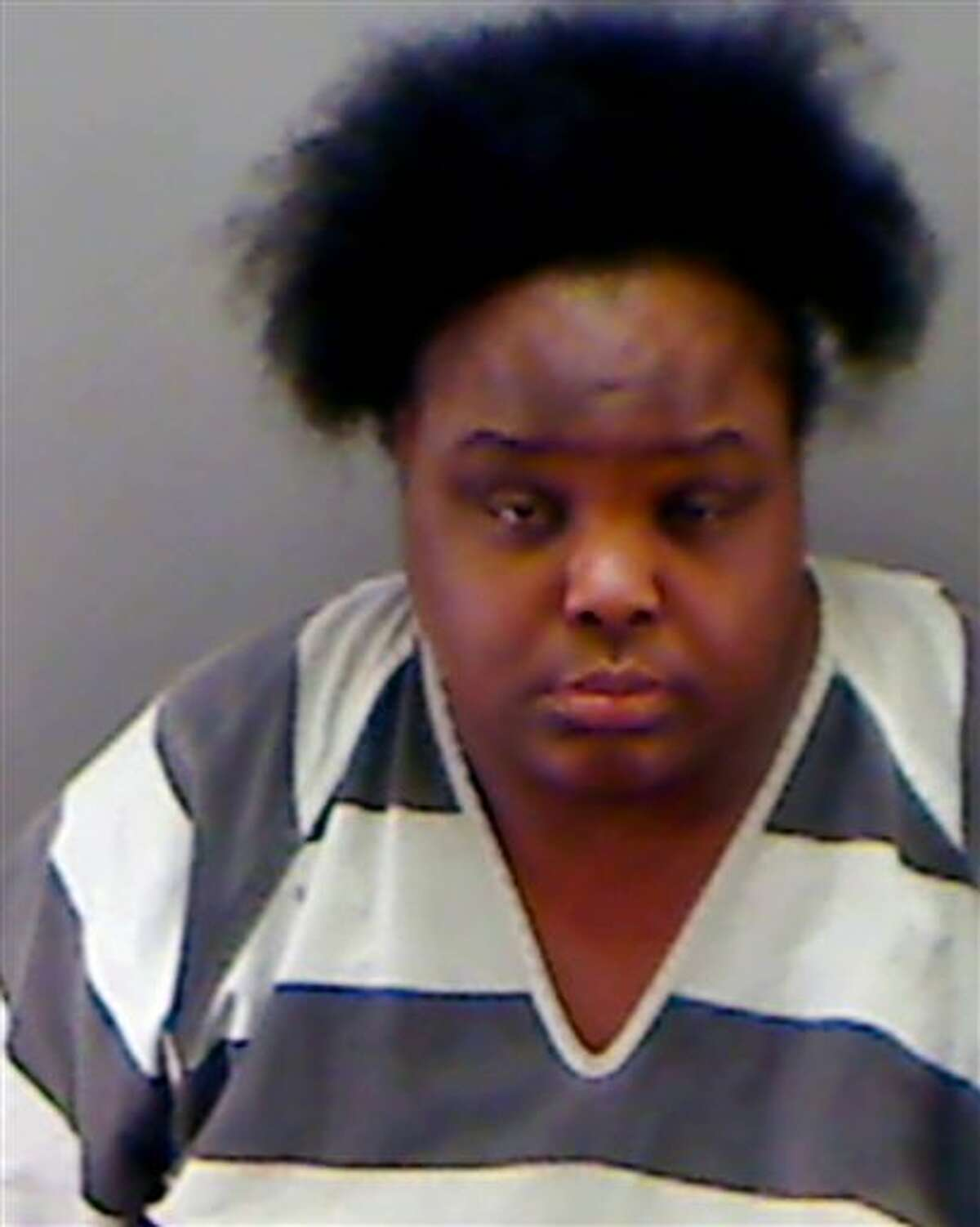 This undated booking photo provided by the Longview Police Department shows Charity Johnson. Authorities say Johnson, 34, posed as a teenager to enroll as a sophomore at a private Texas high school. (AP Photo/Longview Police Department)