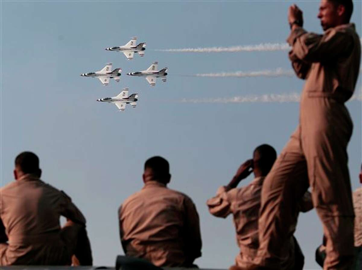 Military personnel watch members of the Air Force Thunderbirds F-16 demonstration team perform during the Thunder Over the Rock Air Show at the Little Rock Air Force Base in Jacksonville, Ark., Saturday, Oct. 9, 2010. (AP Photo/Russell Powell) The Midland CAF AirSho this year will feature the Thunderbirds for the first time since 2001.