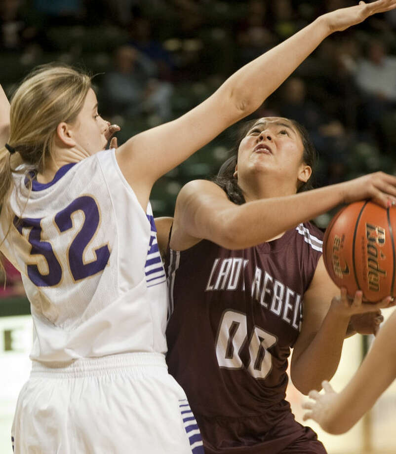 Midland Lee's Yaritza Rivas puts up a shot as Midland High's Claire Lancaster defends Saturday in the third place game of the Bryon Johnston Holiday Classic. Tim Fischer\Reporter-Telegram Photo: Tim Fischer