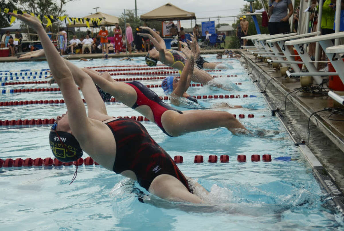 COM Aquatics' Cassidy Hale and others take off at the start last year in the girls 13 and over 100 meter backstroke at the Western National Bank Invitational at Doug Russell Pool. Tim Fischer\Reporter-Telegram