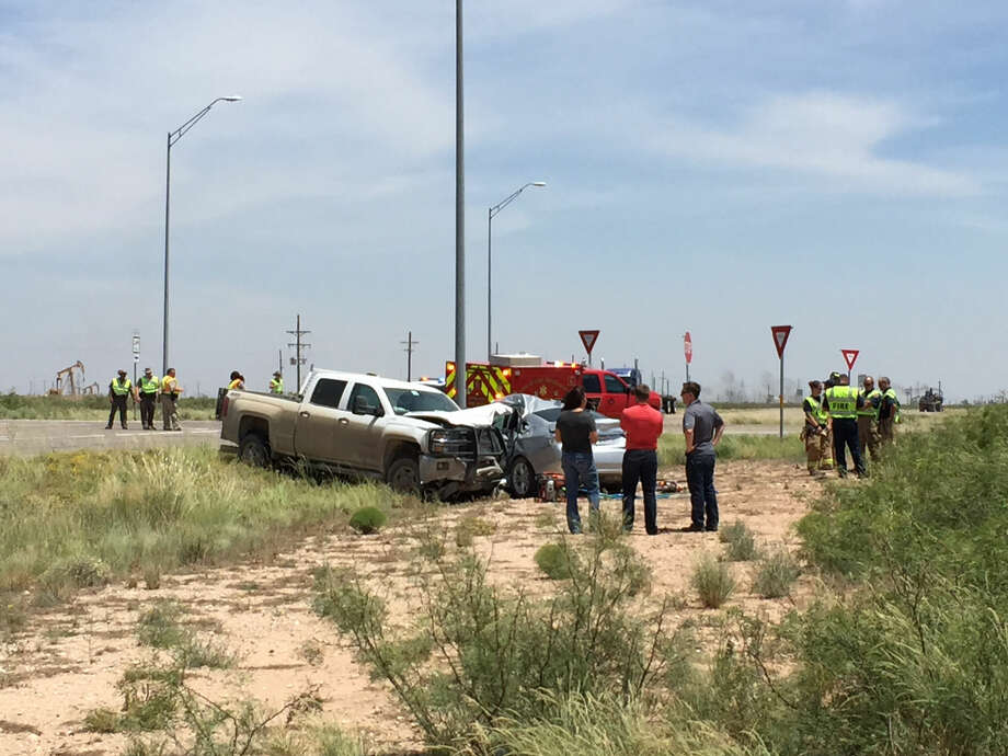 Local law enforcement personnel are at the scene of a fatal wreck at Craddick Highway and West County Road 60. Photo: James Durbin/Reporter-Telegram