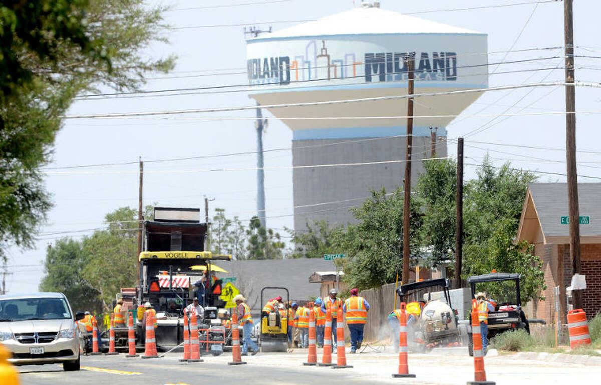 Construction crews work on North Lamesa Rd. near East Pecan Ave. on Wednesday. James Durbin/Reporter-Telegram