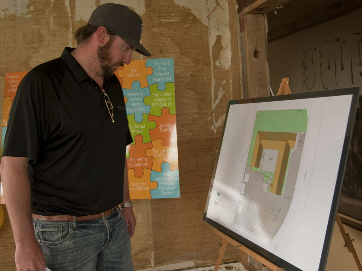 Jacob Tyler, with construction company Pharr & Company, looks over some of the initial drawings Thursday, 5-28-15, at the new building for Centers for Children and Families as they have completed their capital campaign to renovate the new property on Andrews Hwy. Tim Fischer\Reporter-Telegram