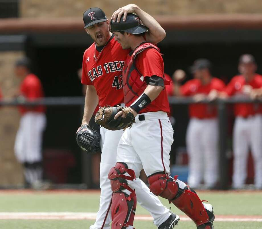 Texas Tech's Chris Sadberry (42) celebrates with Hunter Redman, right, after an out against College of Charleston during an NCAA college baseball tournament super regional game in Lubbock, Texas, Saturday, June 7, 2014. Texas Tech won 1-0. (AP Photo/Lubbock Avalanche Journal, Shannon Wilson) Photo: Shannon Wilson