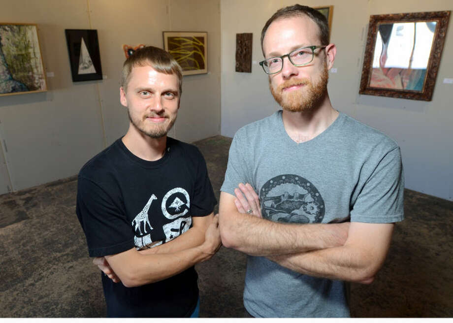 Scott and Elliott Lunson pose for a photo in the KamiPosi Gallery on Tuesday. James Durbin/Reporter-Telegram Photo: James Durbin