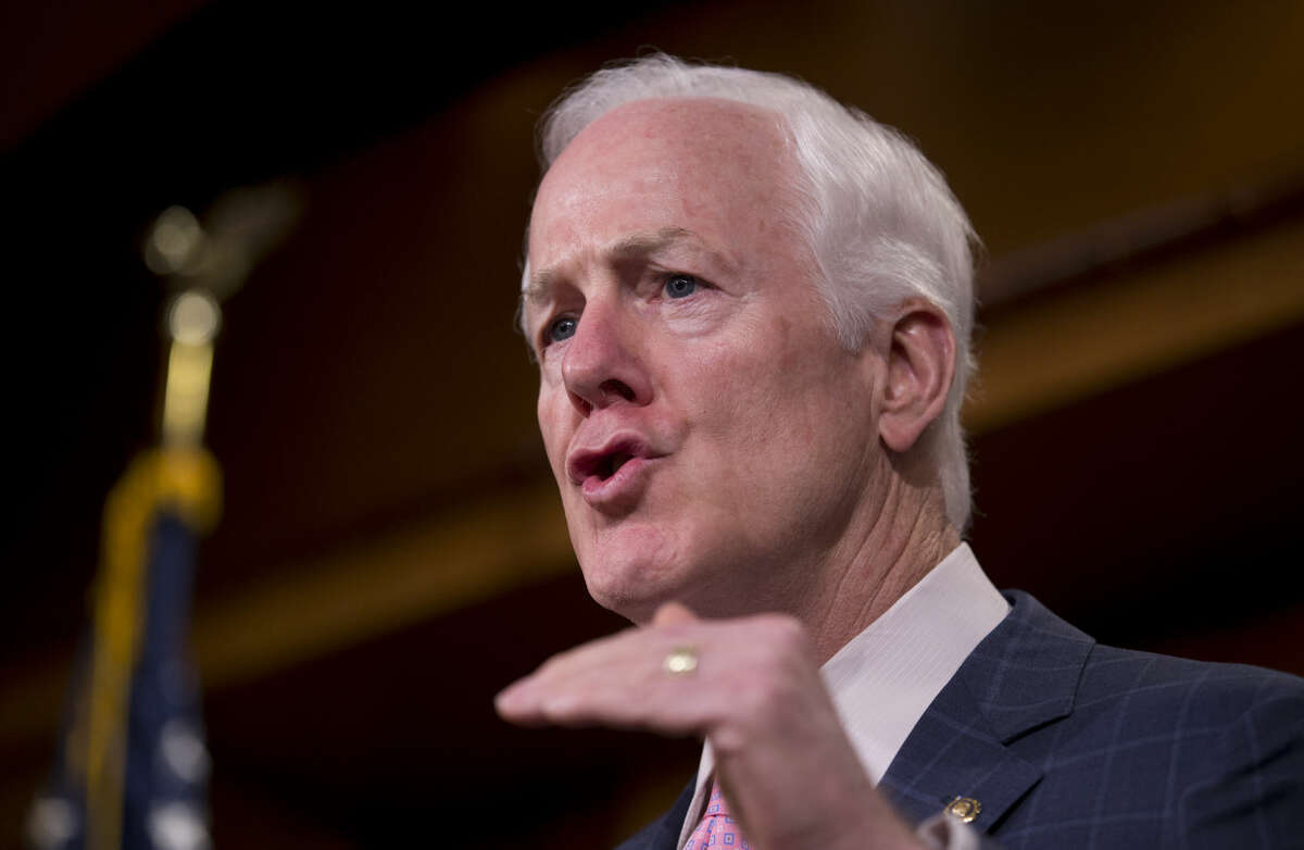 FILE - In this July 29, 2015 file photo, Senate Majority Whip John Cornyn of Texas speaks during a news conference on Capitol Hill in Washington. With the support of the National Rifle Association, Cornyn is introducing legislation to reward states that send more information about residents with serious mental problems to the federal background check system for firearms purchasers, the lawmaker said Wednesday. (AP Photo/Manuel Balce Ceneta, File)