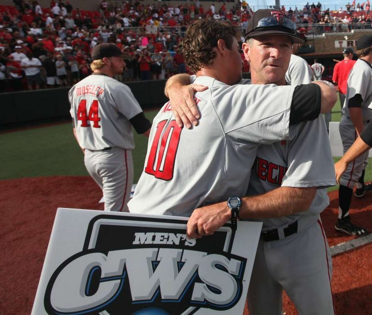 Texas Tech's Tyler Neslony (10) hugs head coach Tim Tadlock after a win over College of Charleston in an NCAA college baseball Super Regional tournament game in Lubbock Sunday, June 8, 2014. Texas Tech advanced to the College World Series for the first time with a 1-0 victory over College of Charleston. (AP Photo/Lubbock Avalanche Journal,Zach Long)