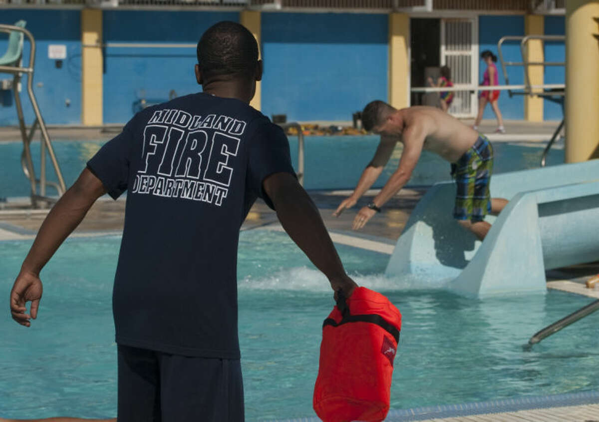 MFD training recruit London Webb throws a safety line as he and others practice water rescue techniques Thursday at Washington Pool. Tim Fischer\Reporter-Telegram