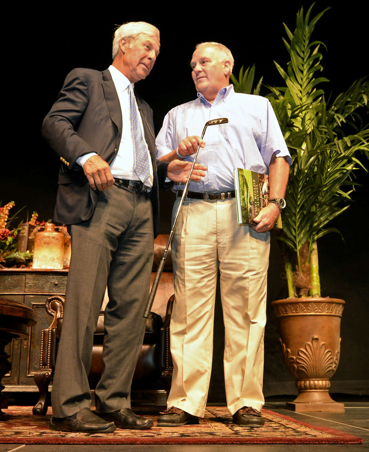 Golf legend Ben Crenshaw presents an autographed used game putter to Peter Courtney, president of H.L. Brown Operating, after selling it as a surprise auction item during the Centers for Children and Families annual fundraiser dinner banquet Thursday, August 6, 2015 at Horseshoe Pavilion. James Durbin/Reporter-Telegram