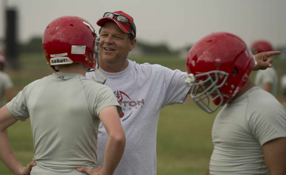 Stanton head coach John Peterson talks with his players as they run drills Tuesday 8-4-15, during the first week of football practice. Tim Fischer\Reporter-Telegram Photo: Tim Fischer