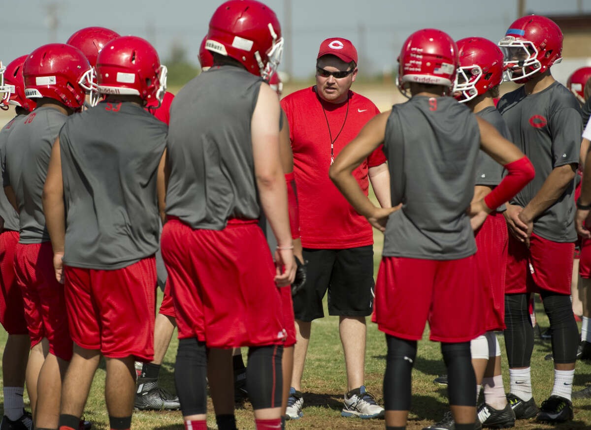 Coahoma's new head coach Fred Dietz works with his players Wednesday 8-5-15, during practice. Tim Fischer\Reporter-Telegram