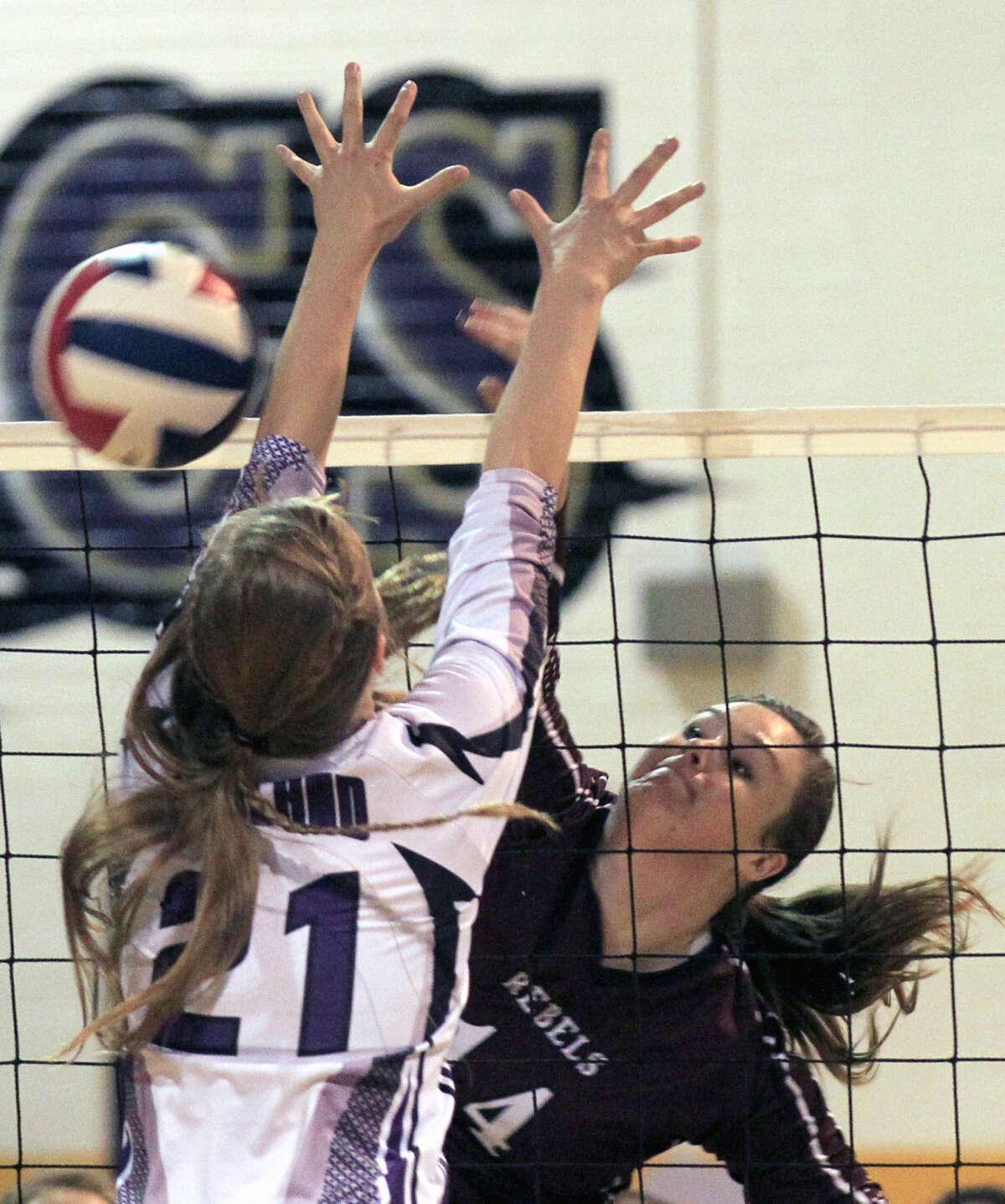 Lee's Darby O'Grady (14) hits past Midland High's Krista Epley (21) last season at MHS. James Durbin/Reporter-Telegram
